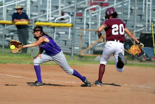 Bristol Central's Chandler Walker is safe at first as Westhill's Megan D'Alessandro reaches for the ball during Tuesday's class LL semifinal game against Bristol Central at DeLuca Field in Stratford on June 7, 2011. Photo: Lindsay Niegelberg / Connecticut Post
