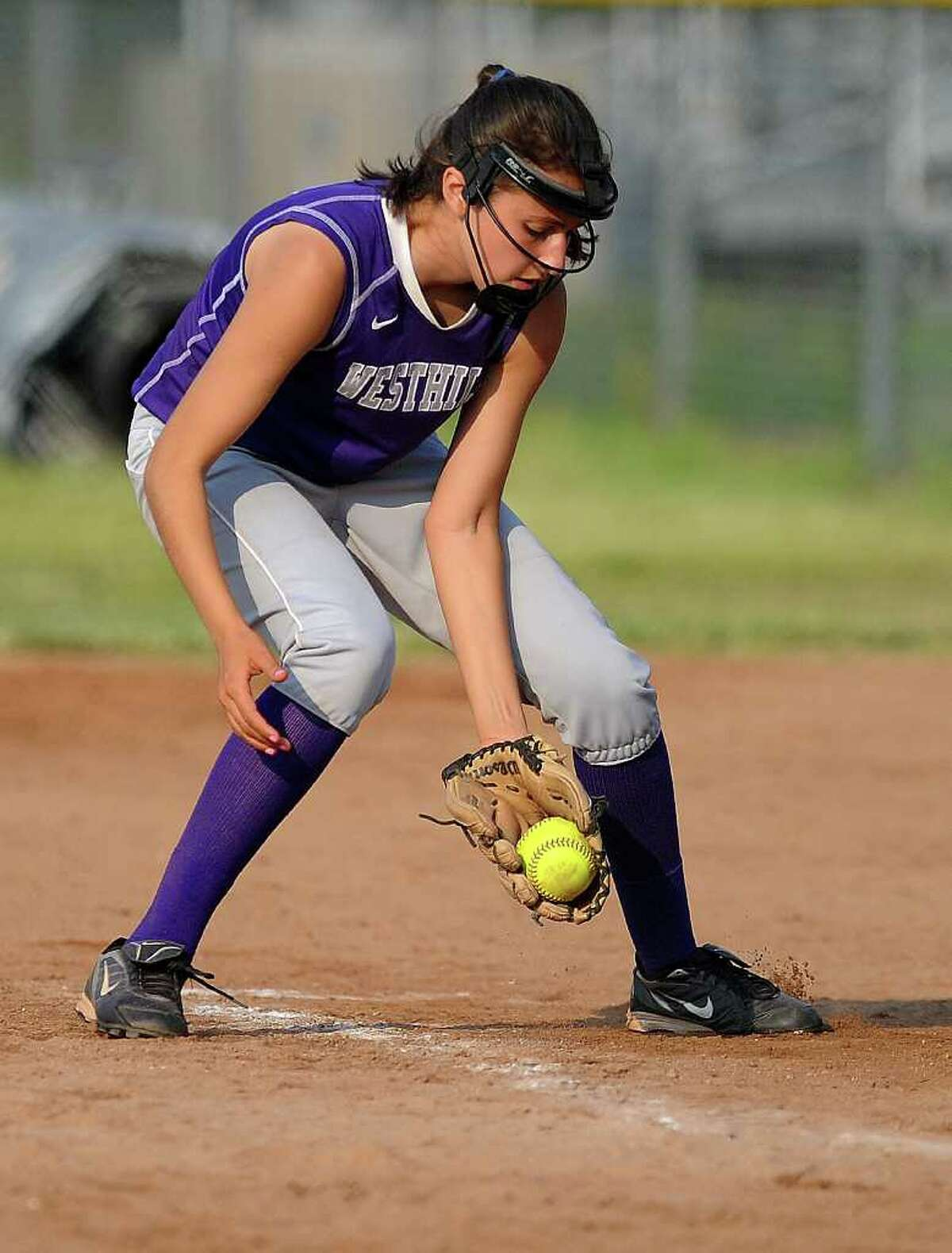 Westhill's Megan D'Alessandro reaches for the ball during Tuesday's class LL semifinal game against Bristol Central at DeLuca Field in Stratford on June 7, 2011.