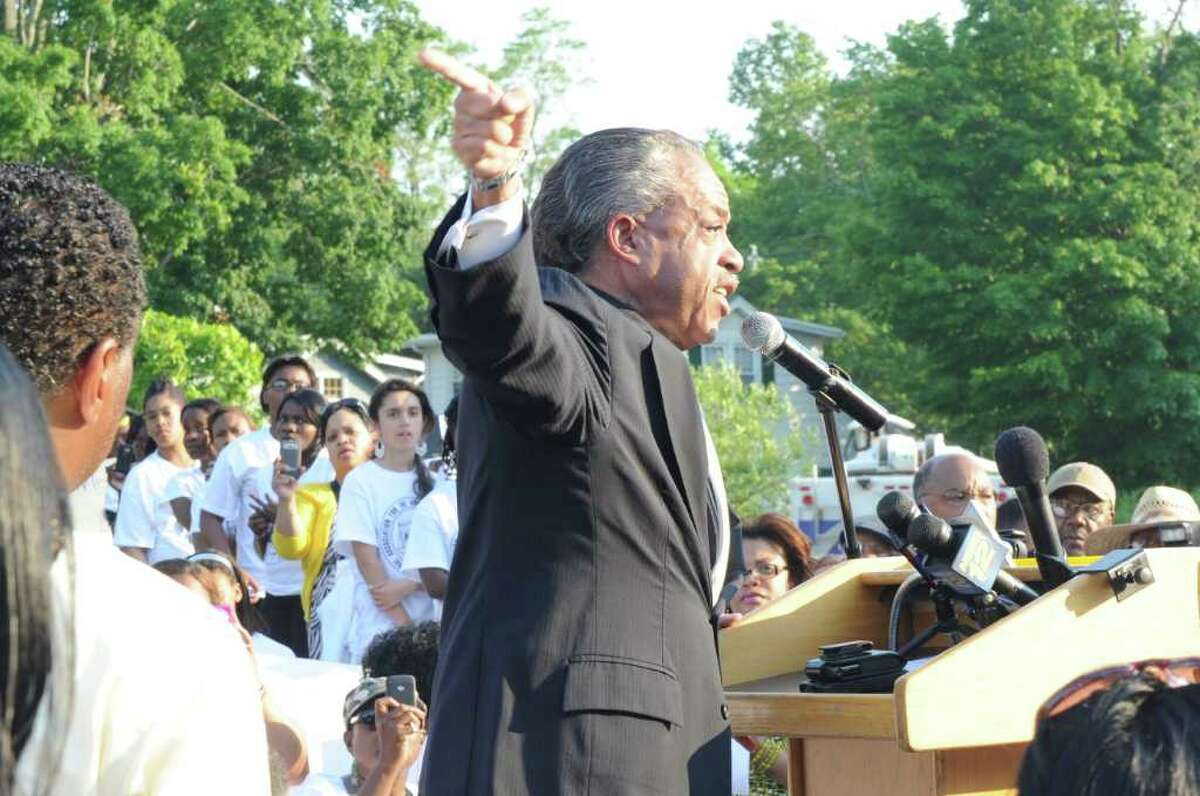 Rev. Al Sharpton takes the stage during the NAACP