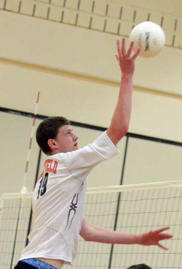 Ridgefield's Alexander Cooper (19) makes a kill against Cheshire during the Class L state boys volleyball championship tournament hosted at Shelton Intermediate School on Tuesday, June 7, 2011. Photo: Amy Mortensen / Connecticut Post Freelance