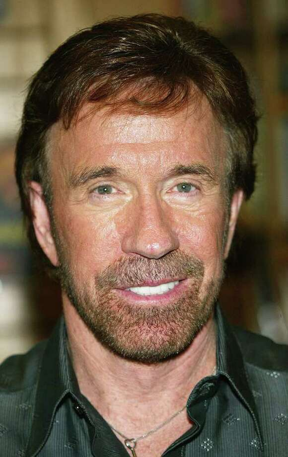 "Chuck Norris would kindly deliver a roundhouse for Romney. In a ""dire warning for America"" posted on his Youtube channel, Norris and his wife warned of a ""1,000 years of darkness"" if Obama gets re-elected. Photo: Frederick M. Brown, Getty Images / 2004 Getty Images"
