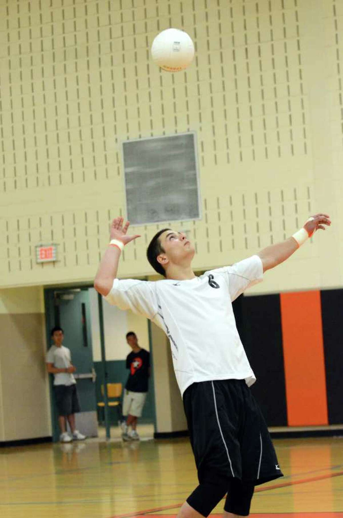 Ridgefield's Ian Word serves to Cheshire during the Class L state boys volleyball championship tournament hosted at Shelton Intermediate School on Tuesday, June 7, 2011.