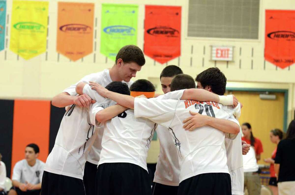 Ridgefield in a team huddle during the Class L state boys volleyball championship tournament against Cheshire hosted at Shelton Intermediate School on Tuesday, June 7, 2011.