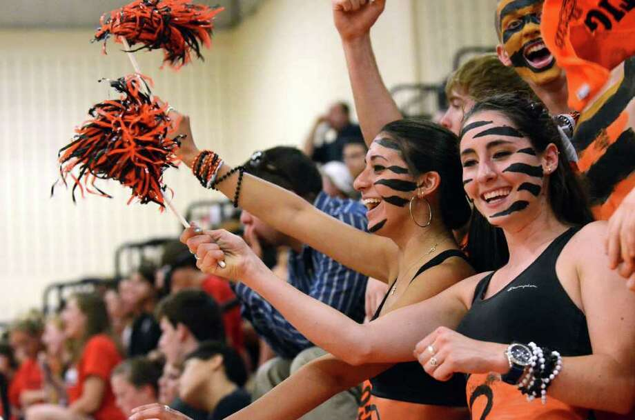 Ridgefield High School seniors Nicole Coviello and Molly Trillo show their Tiger Pride during the Class L state boys volleyball championship tournament against Cheshire hosted at Shelton Intermediate School on Tuesday, June 7, 2011. Photo: Amy Mortensen / Connecticut Post Freelance