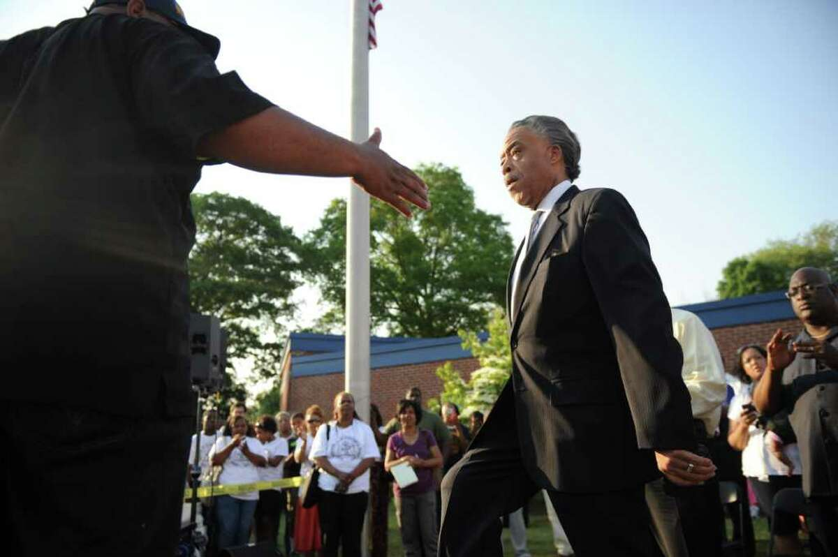 """Rev. Al Sharpton takes the stage during the NAACP """"Equal Education for All"""" rally at Brookside Elementary School in Norwalk, Conn., Tuesday, June 7, 2011. The rally was in support of Tanya McDowell, a homeless woman from Bridgeport, Conn., arrested for enrolling her child at Brookside, a Norwalk, Conn., school."""