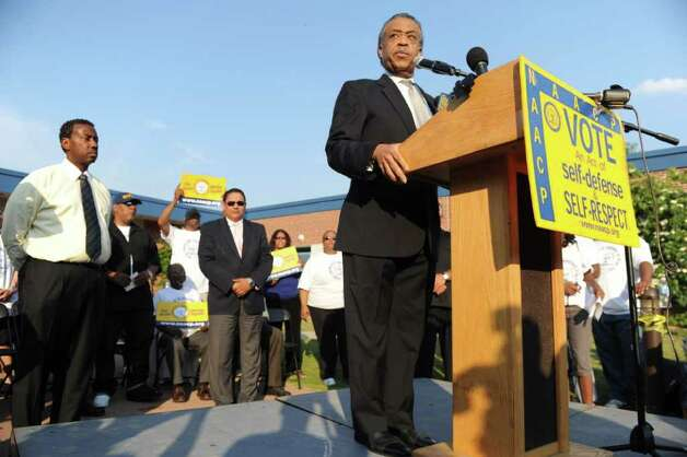 "Rev. Al Sharpton takes the stage during the NAACP ""Equal Education for All"" rally at Brookside Elementary School in Norwalk, Conn., Tuesday, June 7, 2011. The rally was in support of Tanya McDowell, a homeless woman from Bridgeport, Conn., arrested for enrolling her child at Brookside, a Norwalk, Conn., school. Photo: Keelin Daly / Stamford Advocate"