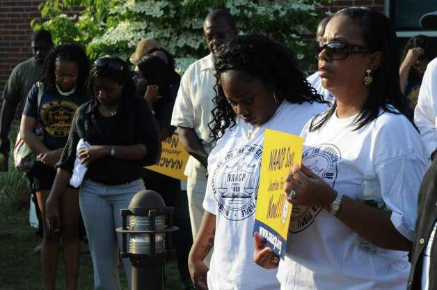 "Tanya McDowell, center, during the NAACP ""Equal Education for All"" rally at Brookside Elementary School in Norwalk, Conn., Tuesday, June 7, 2011. The rally was in support of McDowell, a homeless woman from Bridgeport, Conn., arrested for enrolling her child at Brookside, a Norwalk, Conn., school. Rev. Al Sharpton spoke at the event. Photo: Keelin Daly / Stamford Advocate"