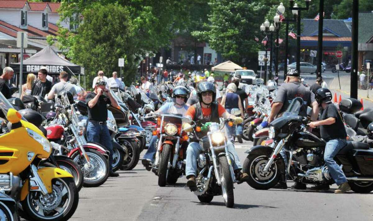 Motorcyclists crowd a Beach Road parkinglot in Lake George during the annual Americade rally Tuesday June 7, 2011. (John Carl D'Annibale / Times Union)