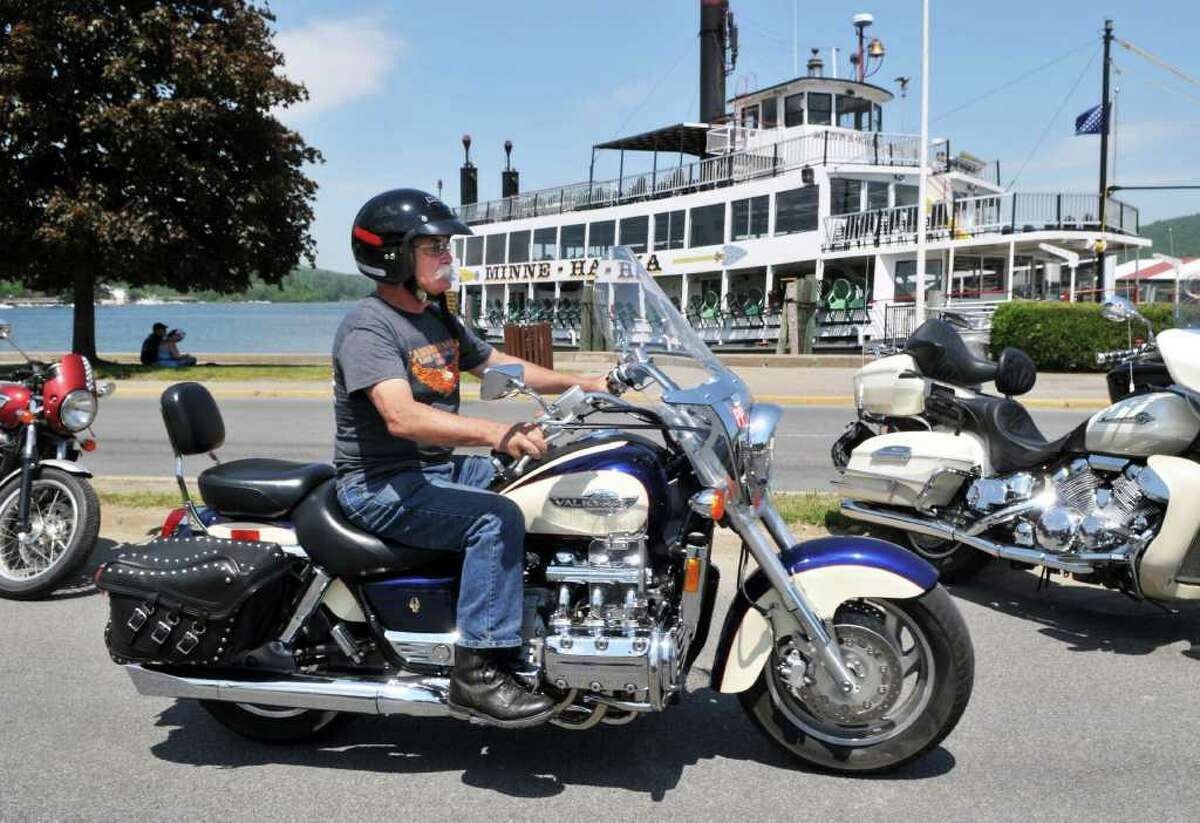 Biker Larry Megan of Poestenkill rides past the