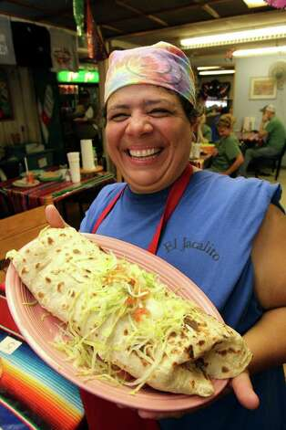 Owner and cook Susan Espinosa displays the three pound burrito at Jacalito Restaurant on May 31, 2011.    Tom Reel/Staff Photo: TOM REEL, Express-News / © 2011 San Antonio Express-News