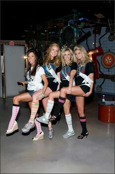 """Micaela Johnson, Miss Nebraska USA 2008; Michelle Gillespie, Miss Kansas USA 2008; Candice Crawford, Miss Missouri USA 2008;  and Lindsey Jo Harrington, Miss Oklahoma USA 2008, show off their socks during the Farouk-sponsored Miss USA/Best Buddies  Nevada """"Sock Hop"""" at the Stomp Out Loud theater lobby in Planet Hollywood Resort and Casino in Las Vegas on March 29. Best  Buddies works to enhance the lives of people with intellectual disabilities by providing opportunities for one-to-one  friendships and integrated employment. The Miss USA finals are on April 11. Photo: Miss Universe L.P., LLLP Photo: Miss Universe L.P., LLLP"""