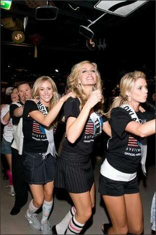 Candice Crawford, Miss Missouri USA 2008, Hailey Laine Brown, Miss Tennessee USA 2008, and Lindsey Jo Harrington, Miss Oklahoma USA 2008, join in a conga line. Photo: Miss Universe L.P., LLLP Photo: Miss Universe L.P., LLLP