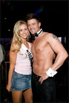 Candice Crawford, Miss Missouri USA 2008, poses with a Chippendale performer while in the VooDoo Lounge. Photo: Miss Universe L.P., LLLP Photo: Miss Universe L.P., LLLP