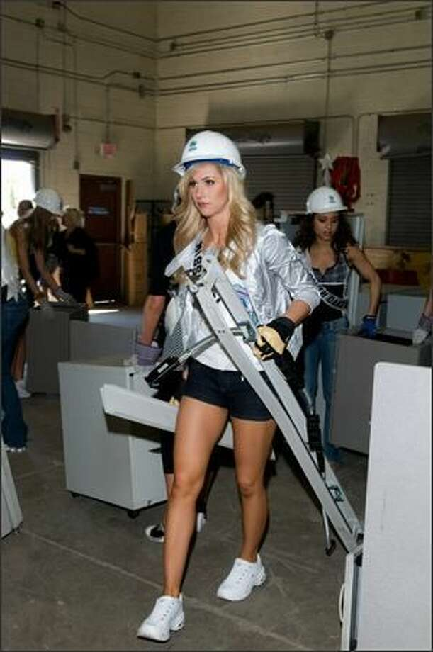 Candice Crawford, Miss Missouri USA 2008, helps organize donations at the Habitat for Humanity warehouse. Photo: Miss Universe 