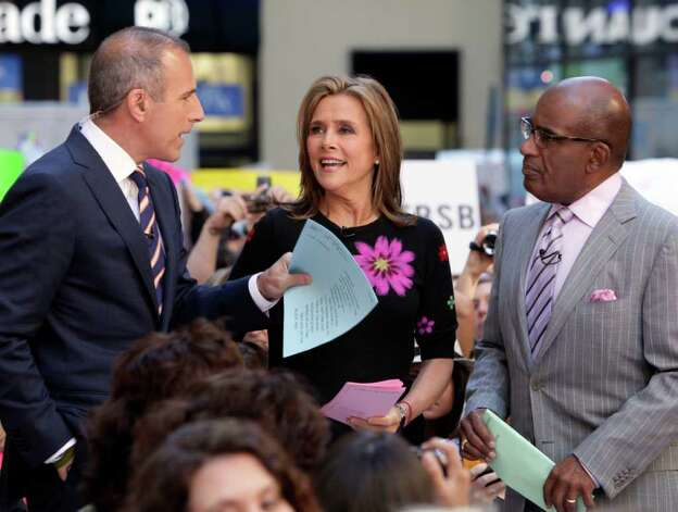 """Co-hosts Matt Lauer, left, and Meredith Vieira, and weathercaster Al Roker,  of the NBC """"Today"""" television program, appear during the show, in New York, Friday, June 3, 2011. Vieira is leaving the progam on June 8. Photo: AP"""