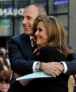 "Co-hosts Matt Lauer and Meredith Vieira  of the NBC ""Today"" television program, embrace during the show, in New York, Friday, June 3, 2011. Vieira is leaving the show on June 8. Photo: AP"
