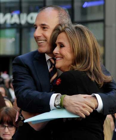 """Co-hosts Matt Lauer and Meredith Vieira  of the NBC """"Today"""" television program, embrace during the show, in New York, Friday, June 3, 2011. Vieira is leaving the show on June 8. Photo: AP"""