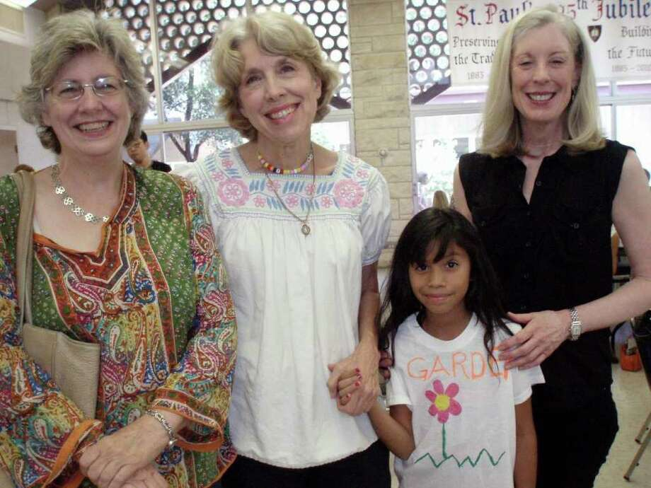 At St. Paul's Episcopal Montessori's end of year performance, board member Lou Taylor (from left) headmistress Kay Mijangos, student Stephanie Melendez and director of music Kathy Kelly say good-bye for the summer.