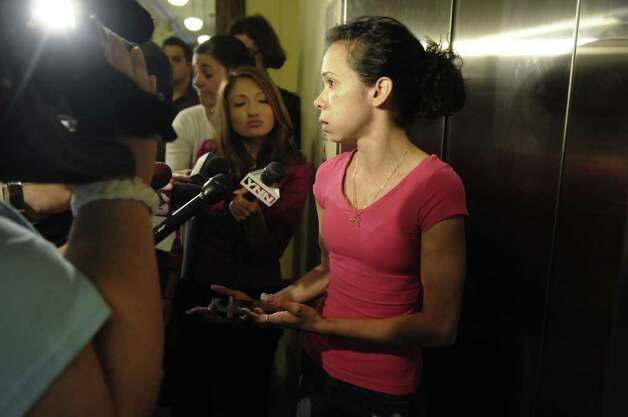 Yamillet Galarza, who said she is the fiancee of Roy Sanders, talks with members of the media following a court appearance where Sanders pleaded guilty at Rensselaer County Court on Wednesday, June 8, 2011, in Troy.  Sanders pleaded guilty to all charges pertaining to his involvement in the driving accident where Jahvion Perez was struck twice by the truck Sanders was driving, and killed at 7:46 p.m. outside his family's home at 392 10th St.   (Paul Buckowski / Times Union  archive) Photo: Paul  Buckowski / 00013462A
