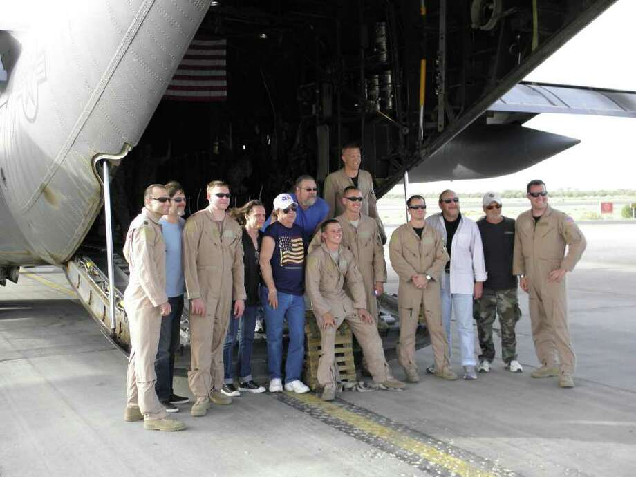 The Marshall Tucker Band in Iraq with the Air Force flight team of a C-130. Doug Gray is third from right. (Photo courtesy of Ramblin' Records)