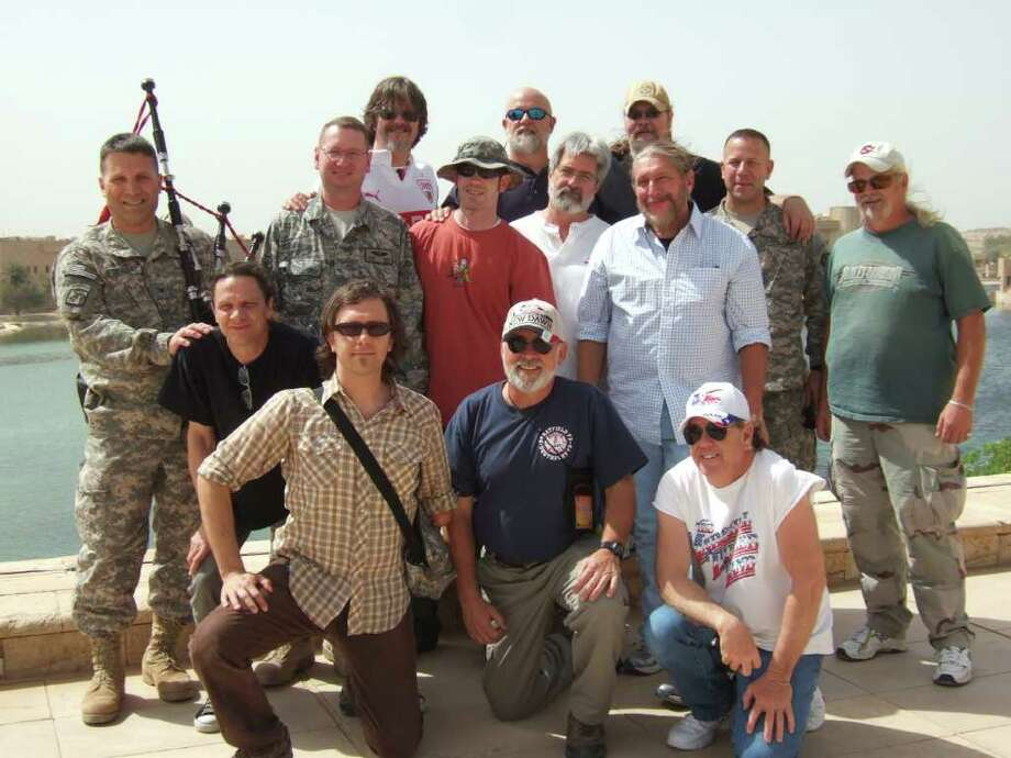 Marshall Tucker Band in Iraq -- at Camp Victory 2 with the band's crew and General Wood and staff on the roof of Al-Faw Palace in Baghdad. Doug Gray is standing and wearing a light, long-sleeved short with the sleeves rolled up. (Photo courtesy of Ramblin' Records)