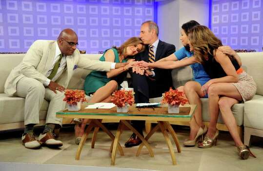 "In this photo released by NBC, ""Today"" show co-hosts Al Roker, Meredith Vieira, Matt Lauer, Ann Curry and Natalie Morales say goodbye to Meredith on her last day on the ""Today"" show, Wednesday, June 8, 2011, in New York. Photo: AP"