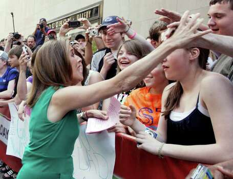 "Meredith Vieira, co-host of the NBC ""Today"" television program, greets audience members in New York's Rockefeller Center during her final show, Wednesday, June 8, 2011. The popular ""Today"" co-anchor ended her five-year run on Wednesday, telling viewers her decision to go is ""right, but it's hard."" Photo: AP"