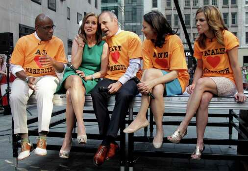 "The cast of the NBC ""Today"" television program, from left: Al Roker, co-hosts Meredith Vieira, and Matt Lauer, Ann Curry and Natalie Morales, get together during a segment of Vieira's last show, in New York Wednesday, June 8, 2011. Vieira, the popular ""Today"" co-anchor ended her five-year run on Wednesday, telling viewers her decision to go is ""right, but it's hard."" Photo: AP"