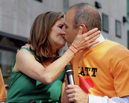 "Meredith Vieira, co-host of the NBC ""Today"" television program, kisses her fellow co-host Matt Lauer, during her final show, in New York Wednesday, June 8, 2011. Vieira, the popular ""Today"" co-anchor ended her five-year run on Wednesday, telling viewers her decision to go is ""right, but it's hard."" Photo: AP"