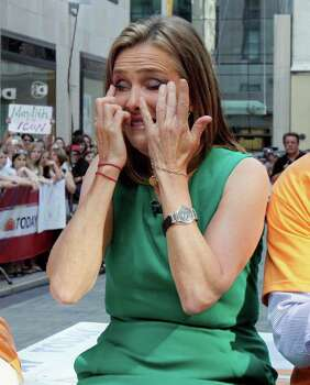 "Meredith Vieira, left, co-host of the NBC ""Today"" television program, sheds a tear  during her final show, in New York, Wednesday, June 8, 2011. The popular ""Today"" co-anchor ended her five-year run on Wednesday, telling viewers her decision to go is ""right, but it's hard."" Photo: AP"