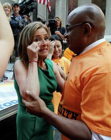 "Meredith Vieira, left, co-host of the NBC ""Today"" television program, sheds a tear with weathercaster Al Roker, and her successor Ann Curry, during her final show, in New York, Wednesday, June 8, 2011. The popular ""Today"" co-anchor ended her five-year run on Wednesday, telling viewers her decision to go is ""right, but it's hard."" Photo: AP"