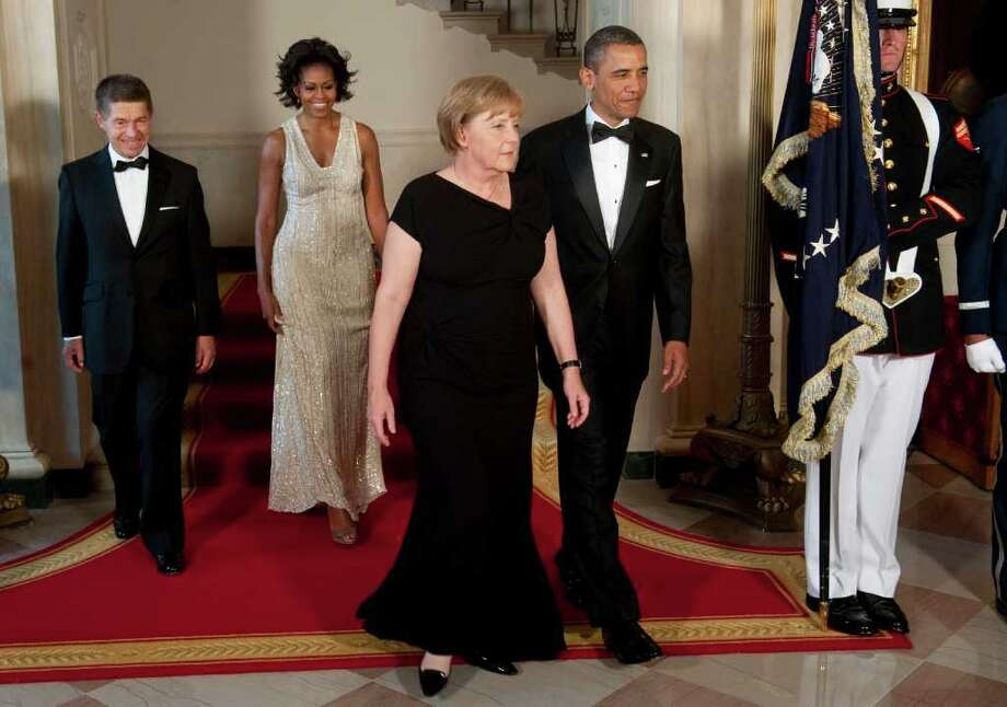 US President Barack Obama (R) and First Lady Michelle Obama (2nd-L) arrive with German Chancellor Angela Merkel (2nd-R) and her husband, Joachim Sauer, for a State Dinner in honor of Merkel at the White House in Washington, DC, June 7, 2011.     AFP PHOTO / Saul LOEB Photo: SAUL LOEB, AFP/Getty Images / 2011 AFP