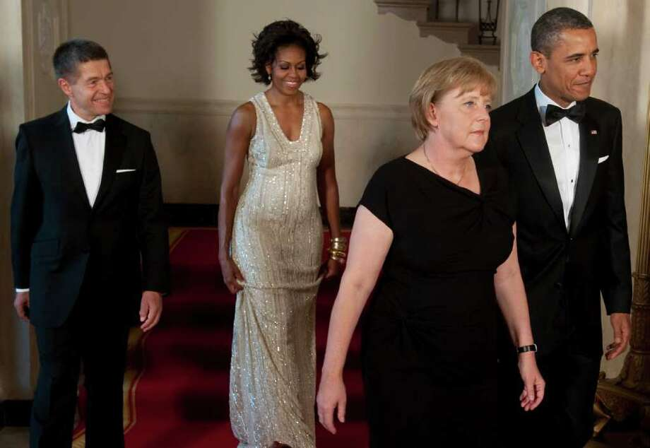 US President Barack Obama (R) and First Lady Michelle Obama(2nd-L) arrive with German Chancellor Angela Merkel (2nd-R) and her husband, Joachim Sauer for a State Dinner in Honor of Merkel at the White House in Washington, DC, June 7, 2011. AFP PHOTO / Saul LOEB Photo: SAUL LOEB, AFP/Getty Images / 2011 AFP