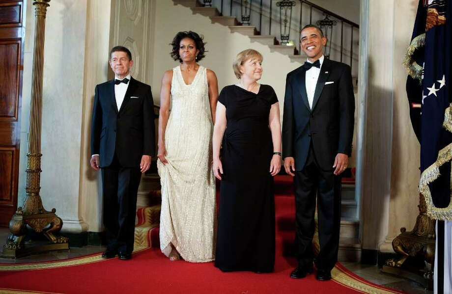From right, U.S. President Barack Obama, Angela Merkel, chancellor of Germany, First Lady Michelle Obama and Joachim Sauer, Merkel's husband, poses for a portrait at the White House on June 7, 2011 in Washington, DC. This is the first official visit by a European leader to the White House since Obama became president. Merkel will be presented with the 2010 Medal of Freedom at a state dinner tonight. Photo: Pool, Getty Images / 2011 Getty Images