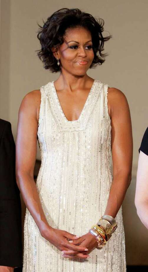 First Lady Michelle Obama poses for a portrait before a State Dinner for Angela Merkel, chancellor of German, at the White House on June 7, 2011 in Washington, DC. This is the first official visit by a European leader to the White House since Obama became president. Merkel will be presented with the 2010 Medal of Freedom at a state dinner tonight. Photo: Pool, Getty Images / 2011 Getty Images