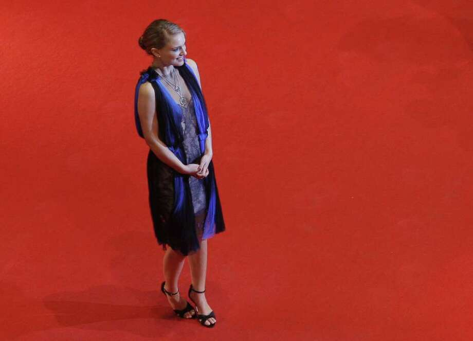 Portman poses for photographers as she arrives on the red carpet for the premiere of the film 'The Other Boleyn Girl' during the 58th International Berlinale Film Festival in Berlin on February 15, 2008. Photo: MARCUS BRANDT, Getty Images / 2008 AFP