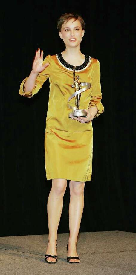 Portman poses at the Paris Las Vegas during ShoWest, the official convention of the National Association of Theatre Owners on March 16, 2006 in Las Vegas, Nevada.  Portman was named Female Star of the Year. Photo: Ethan Miller, Getty Images / 2006 Getty Images