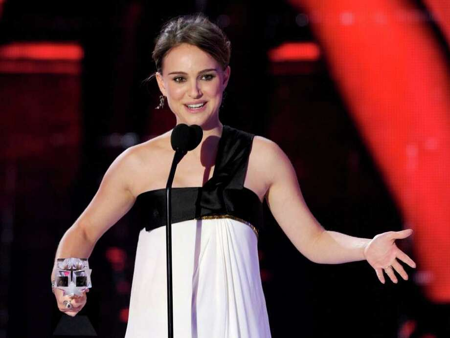 Thanks to 'Black Swan,' it's been a busy awards season for Portman. Since she's pregnant, this means she's had to order up perhaps an unprecedented variety of maternity gowns. Here, she accepts the Best Actress award onstage during the 16th annual Critics' Choice Movie Awards at the Hollywood Palladium on January 14, 2011 in Los Angeles. Photo: Kevin Winter, Getty Images / 2011 Getty Images