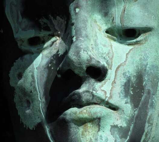 """*** Winner ***  Name: Kate Holodak, Albany  Category: Things Caption: """"Weep No More""""   Image is close up face shot of the sculpture on Myers grave site in Albany Rural Cemetery."""