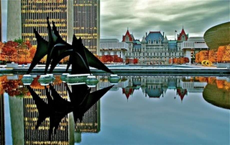 """Gregory Doherty, Albany  """"Calder in the Capitol"""". This photo was taken in the fall just before the reflecting pools were drained. I captured the heart of New York State at its prime. The architecture pictured combine evolution of old school with modern art. The fantastic """"Triangles and Arches"""" by Alexander Calder, and other artwork in the plaza, is a special gift and legacy of Governor Nelson Rockefeller."""