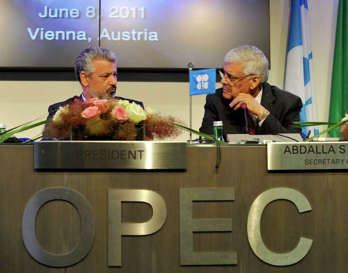Secretary General of the Organization of the Petroleum Exporting Countries (OPEC) Abdullah Al-Badri, right, and Oil Minister of Iran and OPEC President Mohammad Aliabadi, left, talk to each other during a press conference after the OPEC meeting in Vienna, Austria, Wednesday, June 8, 2011. After ministers were unable to reach consensus to raise crude production, OPEC has decided to maintain output levels, with the option of meeting within the next three months for a possible production hike.