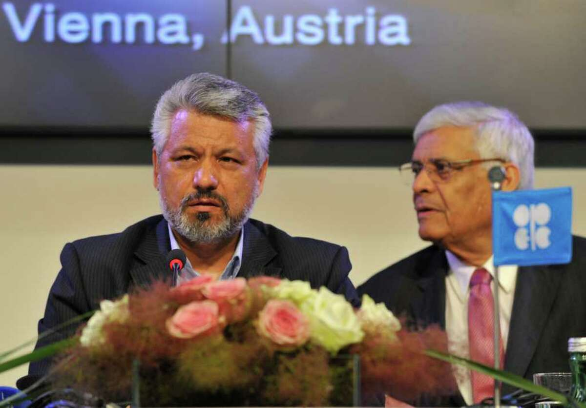 Secretary General of the Organization of the Petroleum Exporting Countries (OPEC) Abdullah Al-Badri, right, and Oil Minister of Iran and OPEC President Mohammad Aliabadi, left, speak during a press conference after the OPEC meeting in Vienna, Austria, Wednesday, June 8, 2011. After ministers were unable to reach consensus to raise crude production, OPEC has decided to maintain output levels, with the option of meeting within the next three months for a possible production hike.