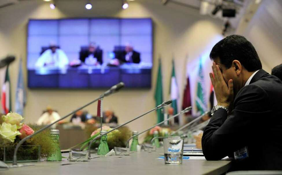 A participant gestures during the meeting of the Organization of the Petroleum Exporting Countries (OPEC) at its headquarters in Vienna, Austria, Wednesday, June 8, 2011.