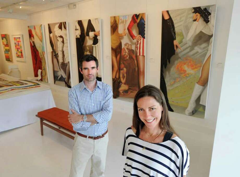 Husband and wife, Lee and Cindy Milazzo, owners of Samuel Owen Gallery at 378 Greenwich Ave., Wednesday afternoon, June 8, 2011. Photo: Bob Luckey / Greenwich Time