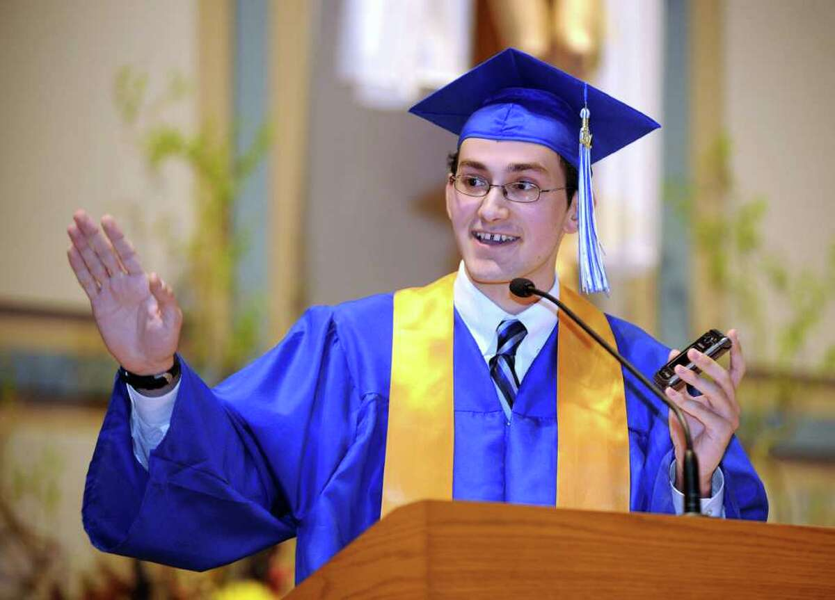 Valedictorian Michael Matthews gives his address Wednesday evening at Immaculate High School's graduation, held at St. Mary Church in Bethel. Photo taken Wednesday, June 8, 2011.
