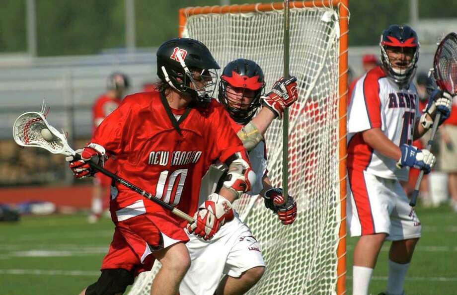 Highlights from CIAC Class M semifinal boys lacrosse action between New Canaan and New Fairfield at Fairfield Warde High in Fairfield, Conn. on Wednesday June 8, 2011. Photo: Christian Abraham / Connecticut Post