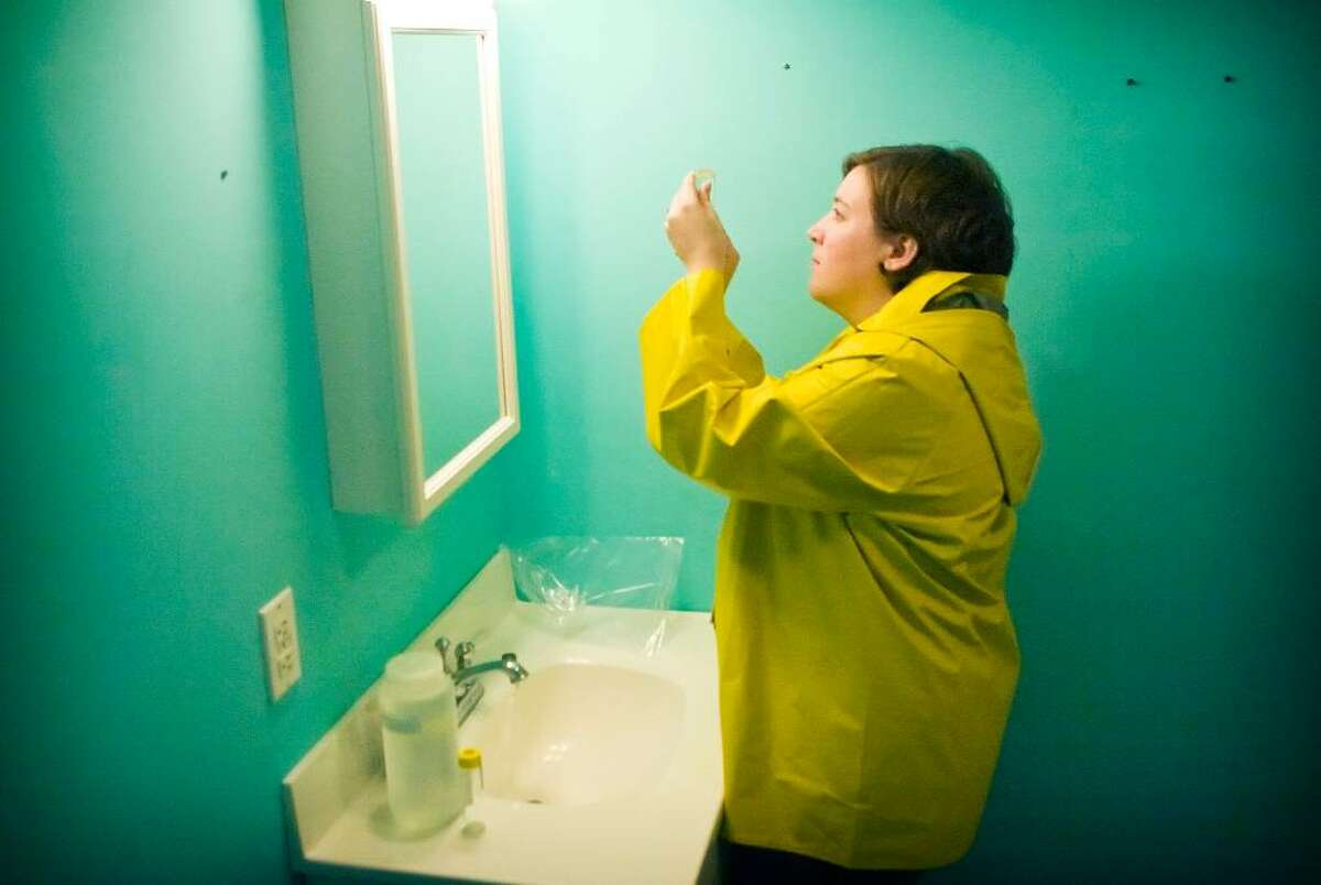 Amy Lehany, a health inspector for the City of Stamford, conducts water sample testing on well water in a home on Hannahs Road on Sunday Sept. 27, 2009. The Health Department is testing the well water of homes near Socfieldtown Park for contaminants.
