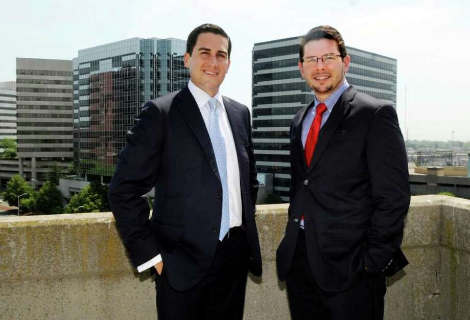 Chris Cortese, left, and Jesse Weber stand at the top of Stamford Town Center in Stamford Tuesday, June 7, 2011. They have opened an NIA commericial real estate firm in Stamford. Photo: Helen Neafsey / Greenwich Time