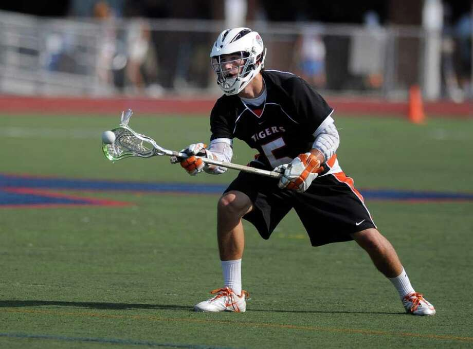 Ridgefield's Andrew Buckanavage passes the ball during Wednesday's game against Staples at Brien McMahon High School on June 8, 2011. Photo: Lindsay Niegelberg / Connecticut Post