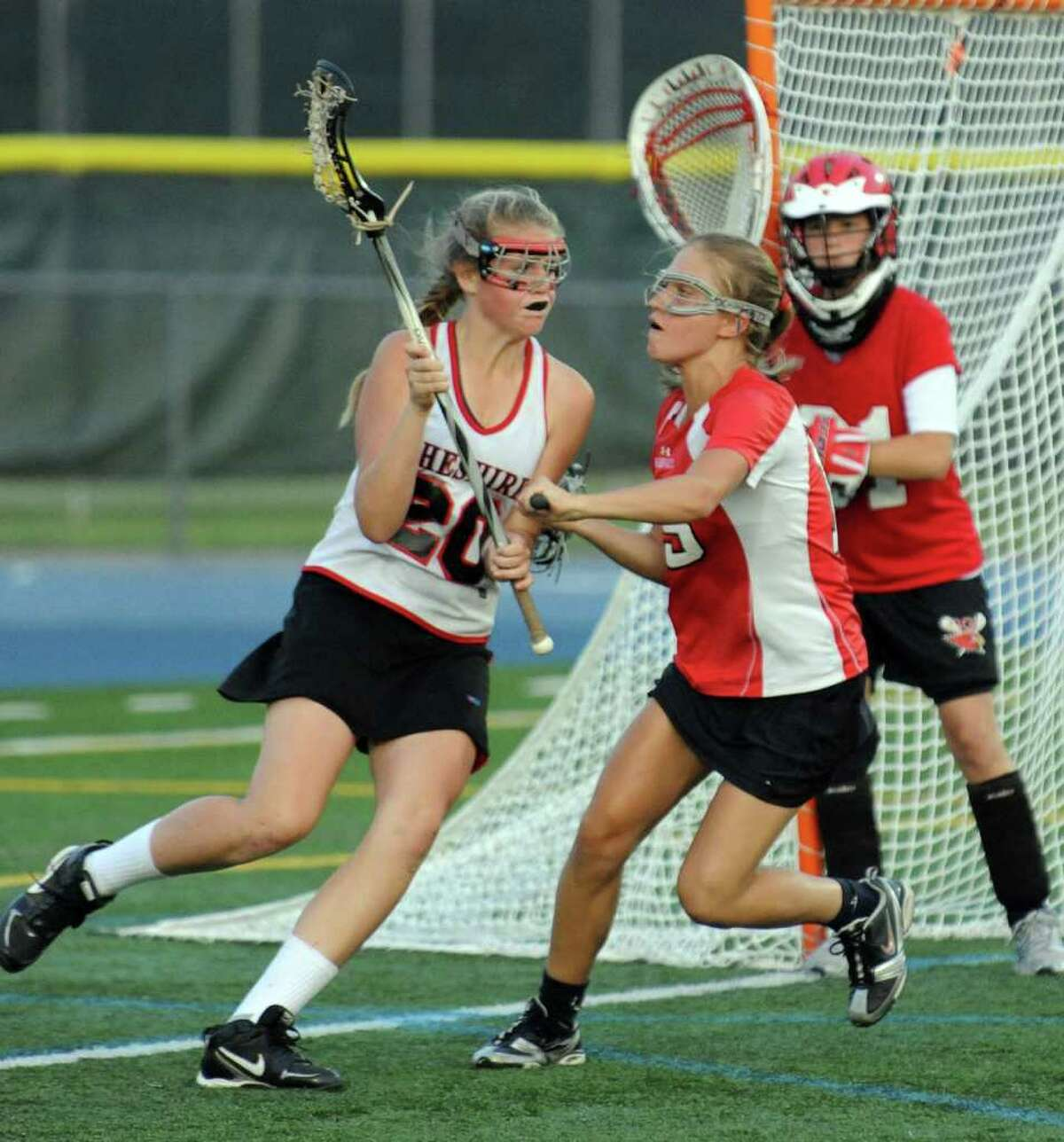 Highlights from CIAC Class L semifinal girls lacrosse action between Greenwich and Cheshire at Bunnell High in Stratford, Conn. on Wednesday June 8, 2011.